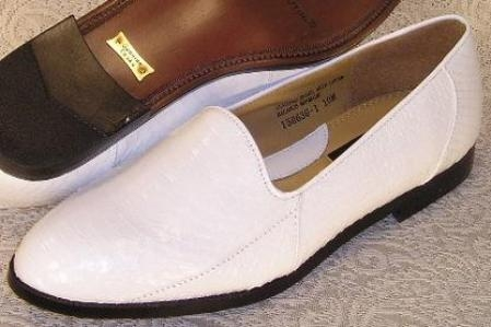 SKU# MUH619 15063 White plain-toe slip-on shoe features a soft snakeskin leather upper, cushioned insole Snake S